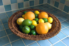 blue ceramic tile countertop with citrus fruit basket