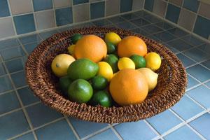 blue ceramic tile countertop with citrus fruit basket