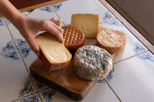 cheese board on a traditional tile countertop