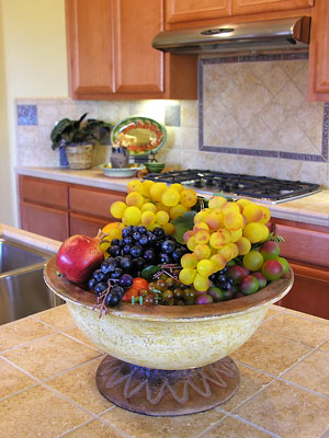 kitchen countertop and backsplash tiles with fruit basket