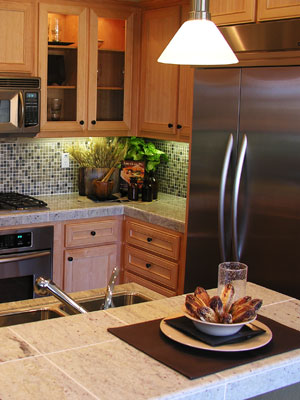 ceramic tile countertops on kitchen peninsula and cabinets
